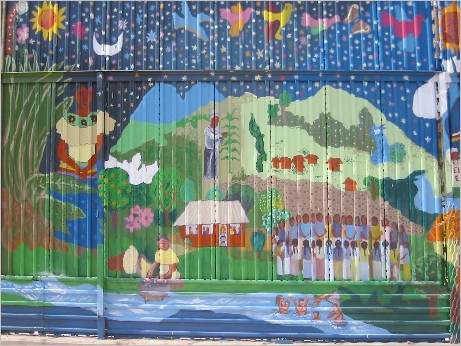 "Reproduction of ""Vida y sueños de la cañada Perla"" [""Life and Dreams of the Perla River Valley""], Mexican side of the U.S. wall at the U.S.-Mexico Border, Nogales, Mexico. Originally painted in Taniperla, Chiapas by Sergio Valdéz Ruvalcaba and destroyed by paramilitary"